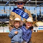MI110264-Tourism and Events Queensland Open Saddle Bronc Champion Tony Caldwell with his children Austin (5yo) and Georgia (6yo)