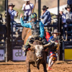 MI110584-Troy Wilkinson marks 83.50pts on board 'Forever Amen' to make it three from three to be the 2021 Mount Isa Mines Bull Ride Champion