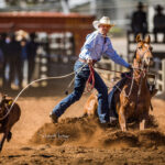 Emerald Cowboy Campbell Hodson gets off his horse in section 3, Rd 1 of the Barkly Hire Rope and Tie contest