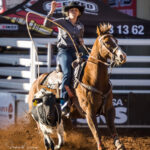 Kylie Hancock and her 11yo gelding 'Pedro' stop the clock in 3.20 secs to take an early lead after the first section of the Ariat Australia Ladies Breakaway Roping